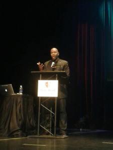 Byron Hurt presenting in SBU's Wang Center auditorium (Source: Amanda Kennedy)