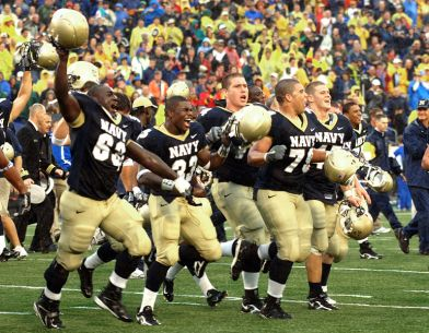 US_Navy_051008-N-9693M-022_Members_of_the_U.S._Naval_Academy_football_team_run_across_the_field_toward_the_home_team_stands_in_celebration_of_their_victory_over_Air_Force_27-24_at_Navy-Marine_Corps_stadium