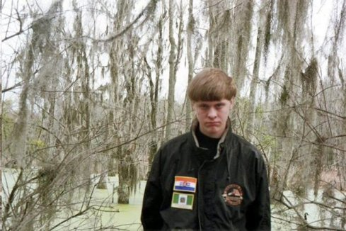 Dylann Storm Roof, wearing racist patches on a military style jacket. Photo from Roof's facebook page (source: New York Times, http://www.nytimes.com/2015/06/19/us/on-facebook-dylann-roof-charleston-suspect-wears-symbols-of-white-supremacy.html)
