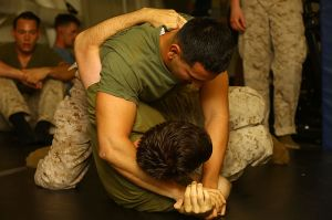 As in ancient Sparta, modern American military training emphasizes physical fitness. Pictured here, two Marines wrestle to demonstrate strength (Source: Wikimedia Commons)